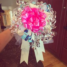 bouquet bow quet for the wedding rehearsal made out of ribbons and bows from the bridal shower gifts