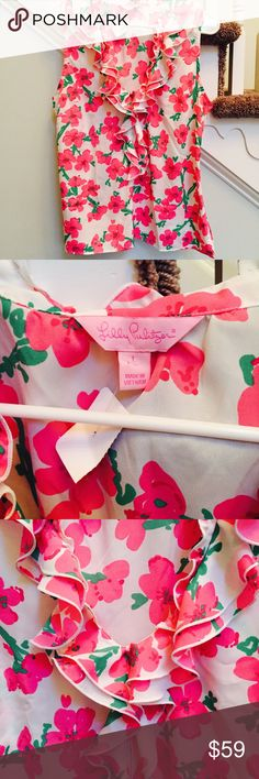 💖Lilly Pulitzer White Blouse w/ Pink Flowers💖 💖Lilly Pulitzer White Blouse w/ Pink Flowers💖 / LIKE NEW! EUC Excellent Used Condition!!! / Size Large / V-Neck/ Center Ruffle with side zip / Beautiful!! Lilly Pulitzer Tops Blouses