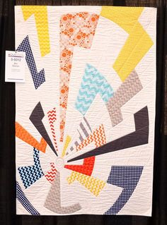 "Interesting ""Off Center"" quilt by Charlotte Noll, as displayed at the August 2014 American Quilter's Society show in Grand Rapids."