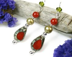 With red-accented glass beads and green freshwater pearls, these handmade beaded earrings bring together complementary colors in a fun and stylish Beaded Earrings, Pearl Earrings, Earrings Handmade, Beaded Jewelry, Stone Beads, Glass Beads, Faux Stone, Red Accents, Christmas Countdown