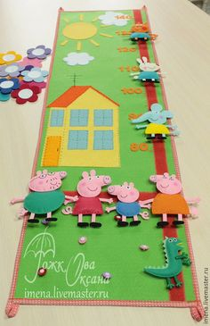 Ростомер с героями мультфильма про свинку Пеппу.