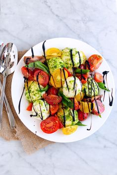 A classic Italian caprese salad starring creamy bites of mozzarella, fresh tomatoes and fragrant basil leaves—all tossed with our Traditional Basil Simply Pesto®. Drizzle it with our sweetly rich balsamic glaze for a stunning contrast of flavors.
