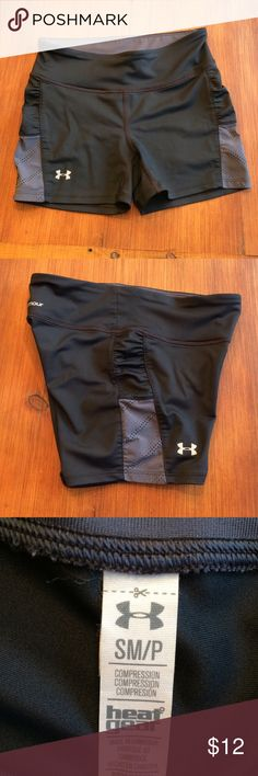 """Under Armour compression shorts Under Armour heat gear compression shorts. Size small. Ruched/mesh area on the sides. Key slot in waistband. Never worn. Waistband and inseam are both 3"""" Under Armour Shorts"""