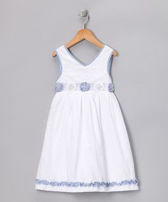 Coming in a hue reminiscent of white gloves, this dress has a kiss of gingham for a hint of color. A hidden zipper down the back is perfect for princesses who like to be prompt.Dress: 100% polyesterLining: 100% cottonMachine washMade in Vietnam