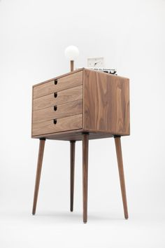 From Auré Aura: Mid Century Chest Our wonderfully modern 4-drawer foyer table features a simplistic mid century design in a fresh but classic mix of walnut and beech.