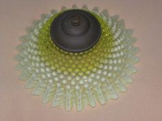 Custard glass and Vaseline /Uranium glass hobnail lamp shade in rbee 's Bonanza booth