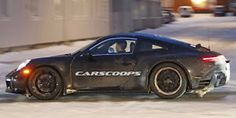 Porsche has been spotted once again testing the next-generation 911 in the snow, but this time with its spoiler sitting flush with the bodywork.