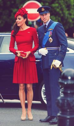 The most gorgeous red dress. (And her handsome companion is a nice accessory. )