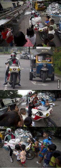 Faith in humanity restored!  Real Kamen Rider distributes toys to underprivileged children in slum areas in Bangkok.