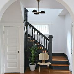 A Traditional Entryway Is Completely Modernized With Just 2 Easy Changes: It's easy to fall for the charm of an old home, even if you're quite modern yourself.