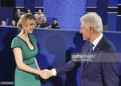Former President Bill Clinton greets Ivanka Trump daughter of Republican presidential candidate Donald Trump before the start of the second...