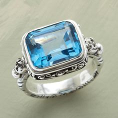 CLEARWATER RING--A pool of jewel beckons from this handmade blue topaz ring in sterling silver. Whole and half sizes 5 to 10.