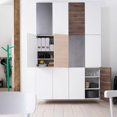 Wall of double-door IKEA kitchen cabinets, stacked two wide and three high.