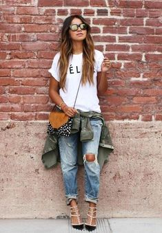 ripped jeans with ankle strap pointy-toe heels, white tee w/ text, green army jacket, cross-body bag and shades.