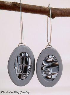 Long Snakeskin Framed Dangles by Charleston Clay Jewelry and Studio. Using my new photo lightbox! http://www.charlestonclayjewelry.com/shopmystore/h2mewuvtvs90uz46iqhrxxuihksqtp?category=earrings