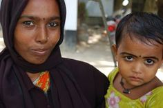 A microcredit borrower with her daughter