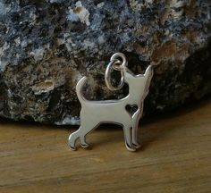 Chihuahua Charm, Sterling Silver Chihuahua Charm with Heart Cutout, Puppy Charm, Charm Bracelet, Dog Charm, Animal Lover, Doggy Charms by VanClarenJewelry on Etsy https://www.etsy.com/listing/267565175/chihuahua-charm-sterling-silver