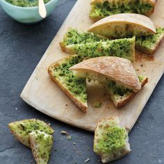 This garlic bread gets its vibrant green color from butter mixed with chopped…
