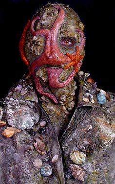 I LOVE THIS! He looks like he belongs in Pirates of the Caribbean. The starfish taking over his face is very well done. I love how much texture is on his face alone.