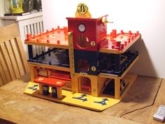 Toy garage, wooden DIY designed and build. Includes battery lightning. Completed and tested