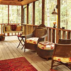 Cozy seating areas all around this porch keep the conversation flowing. A porch swing turns into a favorite reading nook with a warm throw and cushy pillows.