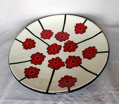 This pottery is hand painted by me. It is food safe, as well as microwave and oven safe. I suggest hand washing to prevent chipping.    This platter is 16 across. It is a great serving piece or decoration. The item pictured is the one you will receive. Colors may vary slightly.    Convo me if you have any questions