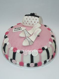 A cake for all shoe and handbag lovers!  Pink, black and white - a fab colour combination!  With a few stripes and handmade sugarpaste buttons for good measure.  This was made as a good luck / leaving to start a new job cake - but would be fantastic for a girl's 16th, 18th or 21st birthday cake!  Or even 30th, 40th, 50th, 60th - as you're never too old for handbags and shoes!