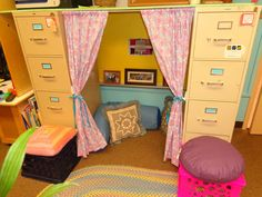 Use two filing cabinets to create a cute cozy corner or quiet area. The curtain rod and simple curtains make this a place where preschool students love to explore and sit and look at their favorite stories. Comfy pillows create a homey feeling. Classroom Setting, Classroom Design, Future Classroom, Classroom Themes, Classroom Organization, Organizing, Classroom Reading Nook, Preschool Reading Corner, Kids Reading