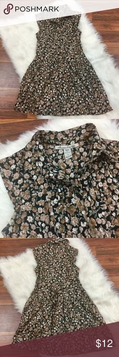 """American Rag Women's Small Brown Floral Dress Adorable AMERICAN RAG dress in size small. Brown and black Floral print. Dropped waist style with tie back. 100% no wrinkle polyester. Cap sleeves. Bust: 37"""", length: 33"""". Excellent condition. American Rag Dresses Midi"""