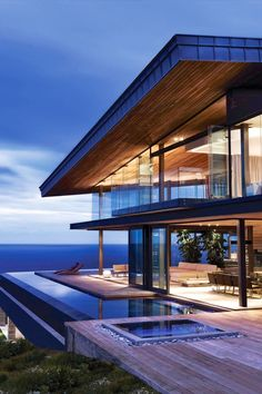 I love the whole concept of this house. It has the infinity pool as soon as you walk out. It has glass walls all the way around for a great view.