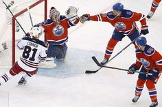 John Woods</p><p>/ The Canadian Press</p><p>Edmonton Oilers' Adam Larsson (6) attempts to knock down the puck in front of goaltender Cam Talbot (33) as Winnipeg...