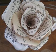"""paper roses made from romance novels << if someone was to give me one made from """"Pride and Prejudice"""" pages I might as well die Newspaper Flowers, Newspaper Crafts, Flower Cake Toppers, Diy And Crafts, Arts And Crafts, Book Crafts, Romance Novels, Book Pages, Vintage Paper"""