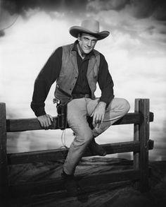 James Arness standing next to a horse, circa 1956.