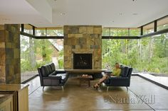 Outdoor living area enclosed with retractable glass walls from NanaWall.