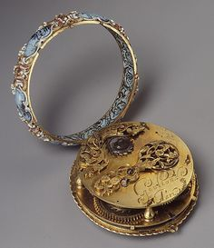 Jeweled pocket watch, 1650 A.D. - on interior of the enamel & gold watch are three images: of young Louis XIV on horseback, a miniature with the arms of France and Navarre, and the Orders of Saint Michael and the Holy Spirit.  (Metropolitan Museum; 4th of 4 pins)