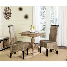 Rich in designer details, this transitional set of two grey wicker dining chairs adds a luxury look to dining rooms, kitchens and casual spaces.