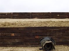 Retaining wall of railroad ties