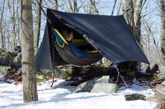 The HouseFly is the latest addition to the rain tarp family, and the most insulated to keep you dry and warm in the snowy backcountry. #hammock #wintercamping