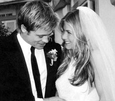 i know its so old news but  LOVE this picture and how natural and intimate it looks Spinoff: who was your FAVORITE celebrity wedding? :  wedding Aniston Brad Jen Picture Pitt Wedding 2