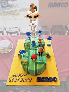 Pokemon Go cake I made for my son's 8th birthday. We made a rotating gym. My son picked dragonite to be on it.