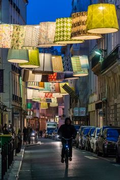 """France, Paris // """"Rue du Mail,"""" a main street housing different designer stores on the right bank was the main stage for LINEN LUX. 62 XXXL-sized linen lanterns were hung all over the street, creating a beautiful and impressive spectacle of light and color."""
