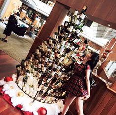 A customer of the Hyatt in Houston, TX enjoying one of our wine bottle trees. #winebottletree #winebottle