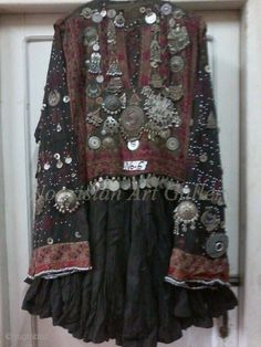 Heavily embroidered Rare Antique Kohistani women Dress, Nicely decorated with Antique Jewellery,From Kohistan Valley,Pakistan.              ...