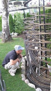 Our trusty train engineer overseeing the Tornado Tower in the Garden Railroad.