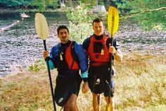The Essential Kayak Equipment: Two paddlers show off their kayak equipment.