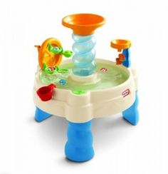 Little dude's other 1st birthday gift! He LOVES playing in water...I will let you know what he thinks of this Little Tikes water table :-)