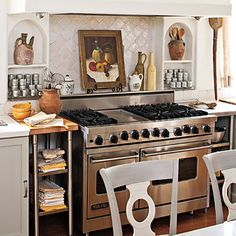Love the vintage style oven and the little butcher block topped shelves on either side.