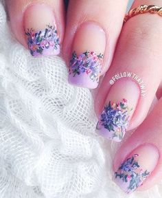 Lovely nails for spring or a bridesmaid if this is the color scheme! Abstract inspired Purple nail art design French tips. you can always go crazy with French tip designs and this one looks just as amazing along with the multi colored polishes that frame the French tip.