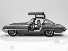 1962 Ford Cougar 406 Concept Car. Debuting at the 1962 Chicago show, the Ford Cougar 406 featured top-hinged, electrically operated gull-wing doors, and came equipped with the new 406 cubic inch V-8. The engine developed 405 horsepower and 448 pound feet of torque. http://www.carstyling.ru/en/car/1962_ford_cougar_406/