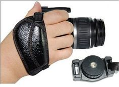 CowboyStudio Hand Strap for Digital & Film SLR Cameras for Canon and Nikon by CowboyStudio. $5.00. From the Manufacturer                 The CowboyStudio Hand Strap The CowboyStudio HS-1 Handstrap is a great addition to your camera and studio.  This hand strap grip is ergonomically designed for comfort and greatly improves your stability & accuracy. The hand pad is designed for extra comfort and security and is created to fit any hand size.  The camera grip allows the photograph...
